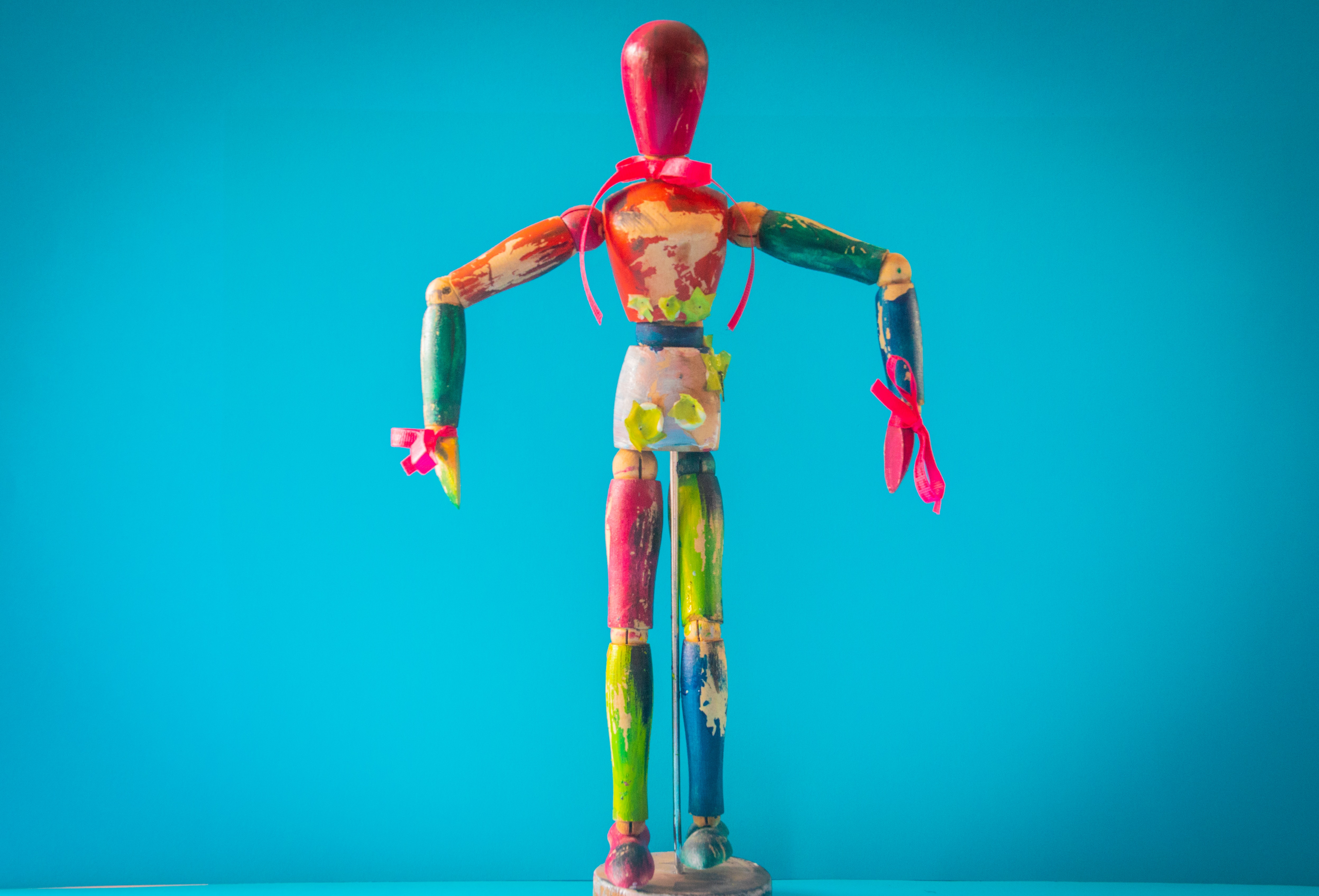 selective-focus-photo-of-multicolored-wooden-mannequin-1333304